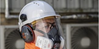 Hard-hat mounted cough guard will help protect site workers